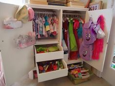 This cabinet was tons of work both inside and outside. I had to add a shelf, dowl rods and hooks. This had a slide out hanging system that I took out. It now stores dress up clothes, doll clothes and all that goes with that. I even use the space under it to store things in plastic bins.