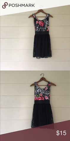 Say What Floral & Lace Dress Say what? brand size small floral print on top with a fitted waist and lace on the bottom. Bust is 30 inches waist is 23 inches length is 30 inches. Top: 95% rayon 5% spandex, bottom shell: 90% polyester 10% spandex, bottom lining: 100% polyester. In excellent condition. Say What? Dresses Mini