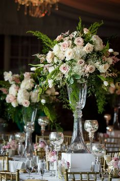 Tall wedding centerpiece composed of white and pink roses designed by Edge Desig. Tall wedding centerpiece composed of white and pink roses designed by Edge Design Group
