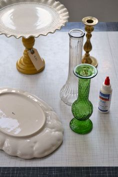 Make a DIY cake stand out of thrift store plates, vases, and candlesticks.
