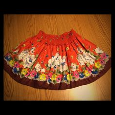 Hollister Floral Skirt This is an orange floral skirt from Hollister in great condition! Only worn once! It is a size small. It also two pockets, one on each side. No rips, tears, or stains! Smoke free home  it is about 13.5 inches from waist to bottom of skirt. Flat the elastic waistband is 12 inches across the front. Hollister Skirts Mini