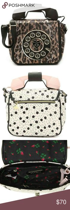 Betsy Johnson Call Me Baby Cheetah print Removeable with headset jack.                    Faux leather Fabric lining Fold over flap Lock closure  Top handle   Removeable shoulder strap Back outer zipper pocket Interior lining features 1 zipper/2 slip pockets 12 x 4.5 x 8.5 Betsey Johnson Bags Crossbody Bags