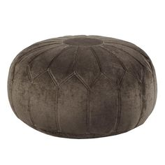 This versatile oversized ottoman pouf will make a statement in any home with its distinctive stitching pattern and soft appearance.