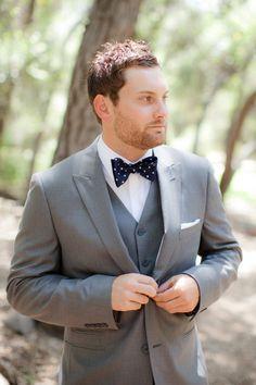Polka dot navy bow tie with grey groom suit Navy Bow Tie, Bow Tie Suit, Polka Dot Bow Tie, Polka Dots, Wedding Groom, Wedding Suits, Wedding Attire, Wedding Dresses, Groom Ties