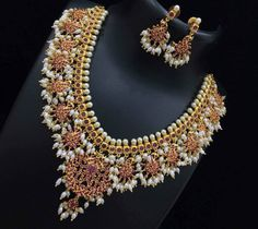 Beautiful necklace with rice pearl hangings. Beautiful temple jewellery necklace studded with pink color stones. Necklace with guttapusalu hangings. 1 Gram Gold Jewellery, Fancy Jewellery, 18k Gold Jewelry, Clean Gold Jewelry, Temple Jewellery, Stylish Jewelry, Jewelery, Pakistani Jewelry, Indian Wedding Jewelry