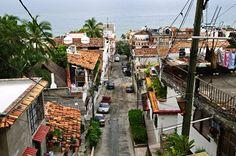 City street in Puerto Vallarta, Mexico. Street leading to Pacific ocean in Puert , Puerto Vallarta, City Streets, Pacific Ocean, Natural, Mexico, Street View, Stock Photos, Creative Resume, Resume Templates