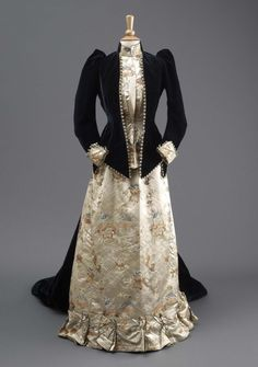 Front view of Mrs Jameson's Dress 1891 by Madame Clapham, embroidery trim on jacket, silk brocade suit, with high collar