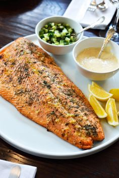 Roast salmon with garlic, dill and lemon with quick cucumber relish