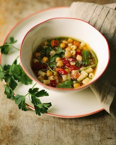 familystyle food: chile chickpea brodo, chorizo and greens