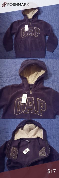 MWT GAP HOODIE NWT GAP hoodie. The zipper all the way up the middle. Embroidered gray around navy letters. Gray thermal in the inside of attached hood. Back is all navy fleece. GAP Kids Shirts & Tops Sweatshirts & Hoodies
