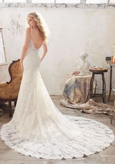 7c3c61c21a1 Malia Wedding Dress Romantic Wedding Dress Featuring Beautiful Allover  Embroidered Lace on Net with Crystal Beaded Double Straps and Scalloped  Hemline.