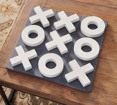 Bring a chic touch to your living space with the Oversized Tic Tac Toe Game. This sturdy coffee table decor features faux-stone pieces on a lightly-distressed base for hours of fun competition. Tic Tac Toe Board, Tic Tac Toe Game, Tic Toe, Modern Game Tables, Board Game Box, Elegant Wedding Themes, Chess Set Unique, Wall Game, Scrabble Wall