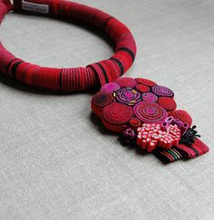 Necklace | Elin Thomas.  Handmade beads made from felt, crochet and polymer clay, vintage tape