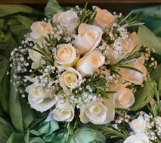 a dainty posy of Akito roses, gypsophilia and rosemary - flowers by Spriggs Florist