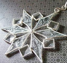 This stained glass snowflake is made from glue chip glass (resembles frost) and 3/4 bevels. I use lead free solder on these items. A lovely