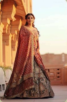 Dark grey gold Rimple and Harpreet Narula lehenga with red banarasi dupatta. Indian Bridal Outfits, Indian Bridal Lehenga, Indian Bridal Fashion, Indian Bridal Wear, Indian Gowns, Red Lehenga, Indian Designer Outfits, Bridal Dresses, Anarkali