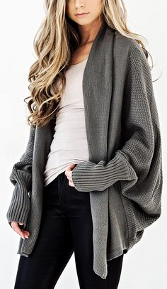 A stunning and ultra cozy Cardigan in a beautiful Dark Sage hue! Our Colbie Dolman Cardigan goes with everything fall in this open neckline wear that features a honeycomb weave throughout. Sport this over your graphic tees or Beso Tops!