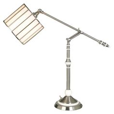 Adjustable swing arm table lamp with a copper foiled stained glass shade.  Product: Table lampConstruction Material:...