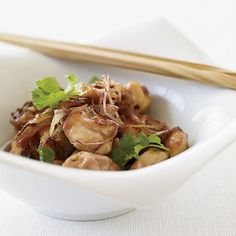 At the Slanted Door in San Francisco, chef Charles Phan prepares spectacular Vietnamese specialties like this intensely sweet and savory peppered chic...