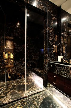 Not feeling the black \/ gold marble but layout perfect for huge luxury steam shower. Love the underseat lighting