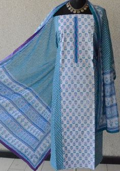 Floral blue print on Jaipur white cotton. Dupatta with purple facing.  Purple 100% pure cotton trousers.  PRICE : ₹ 2300 TO BUY:rangindianwear@gmail.com