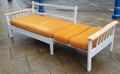 Vintage sofa daybed , extending slide out sideways ( very unique ) , blond arms- possible elm and good strap banding , sturdy built with a painted frame finish .  Origional orange cushions could probably do with being re-upholstered , but perfectly usable.  Viewing available   Collection from Huddersfield   I can store this item for upto 12 weeks to help with collection arrangements. | eBay!
