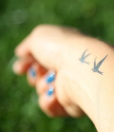 My wrist tattoo, two swallow-like birds I designed