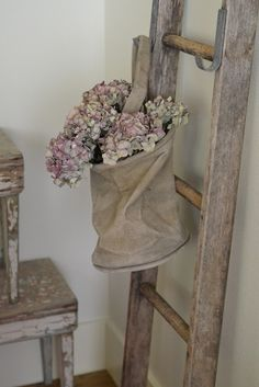 Hydrangeas in canvas french bucket. love the ladder rack yes in my laundry room & love the hydrangeas .