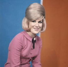 Beehives added several inches of height to many a well-dressed woman in the 1950s and 1960s. Dusty Springfield models the look beautifully here, with a gravity defying beehive, backcombed and lacquered to perfection.