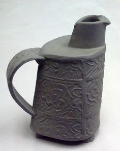 "Unglazed hand-built pitcher, 11"". By Christine Winokur."