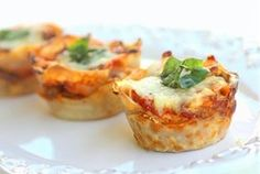 Lasagna Cupcakes (aka hors d'oeuvres)...Next time I may make with something other than Wonton wrapers