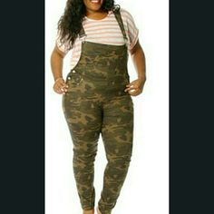 Camouflage or Army Fatigue Overalls/ Jumper A very sexy fitted XL camouflage jumper that shows your curves very well. It has very minimal stretching, so will fit a TRUE size 14 or a really curvy size 12. It's also NWOT and listed as Forever 21 for more views. Forever 21 Pants Jumpsuits & Rompers