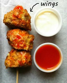 Buffalo Wing Meatballs -- 1 pound ground chicken, 1/2 pound 80/20 ground beef, 3 slices fresh bread, crumbled, 2 eggs, 3/4 cup blue cheese crumbles, 1/4 cup buffalo wing sauce, 3/4 cup celery, finely diced.