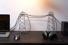 While most of us would want to hide our mess of gadget cables, Daniel Ballou's concept uses them to turn a desk into an industrial landscape. Les Elements, Laide, Cable Organizer, Furniture Catalog, Make Design, Home Hacks, Cozy House, Homes, Interior Design