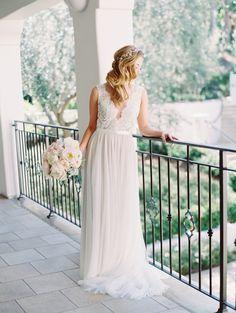Dreamy lace & chiffon Watter's gown: http://www.stylemepretty.com/2015/09/30/classic-outdoor-wedding-at-bacara-resort-spa/ | Photography: Carmen Santorelli -- http://carmensantorellistudio.com/