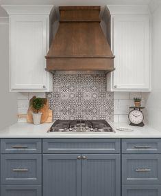 FS Faenza black and white tile backsplash. - - FS Faenza black and white tile backsplash. Kitchen Vent Hood, Kitchen Stove, Kitchen Redo, Kitchen Tiles, Kitchen Cabinets, Wood Hood Vent, Soapstone Kitchen, Kitchen Cupboard, Wood Range Hoods