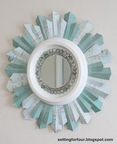 Home Decor - DIY Sunburst Mirror - scrapbook paper, ceiling medallion, and beads. easy peasy.