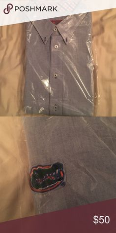 NWOT Men's Blue Pennington&Bailes LS Dress Shirt Orange and Blue Plaid in collar. Gator logo on front right of shirt. Dry cleaned. Long Sleeve. pennington&bailes Shirts Casual Button Down Shirts