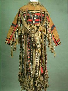 Siberian shaman costume. Lots of dangly bits and bobs of various materials.