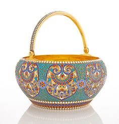 Russian Silver-Gilt and Cloisonné Enamel Sugar Bowl, Gustav Klingert, Moscow, 1894. Ovoid, with hinged handle, enameled with reserves of varicolored stylized flowers and scrolling foliage on a blue and filigree ground.