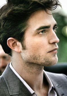 Robert Pattinson http://www.pattinson-art-work.com/2013/08/gifs-time-v-neck-rob-smiling-rob-hair.html?m=1