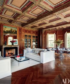 Home Library Bookshelf Design - At a historic New Jersey estate, decorator Matthew Frederick designed the library's sofas, whose simple lines defer to the exuberant architecture; the rug is by Merida.