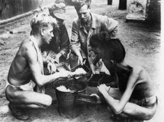 Liberated POWs at a Rangoon jail share a last meal of rice before being evacuated, 3 May 1945.