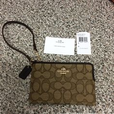 NWT Coach wristlet NWT Coach wristlet. Brown. Length is 6.25 inches. Height is 4 inches. Zipper works. 2 small interior pockets could be used to store cards or I.D. Please make any offer using the offer button. Coach Bags Clutches & Wristlets