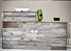 Another shot of the custom reclaimed barnboard reception desk we built in our Hamilton shop and delivered to The Fluffy Carnivore pet food store.  We used our classic grey barn board and topped it off with rustic brown boards carefully sanded and clear coated.  We love adding our reclaimed material to commercial and retail projects - contact us through the website to help out on your next project.  For your raw pet food needs check out @thefluffycarnivore #desk #receptiondesk #barnboard…