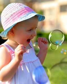 Little girl playing with soap bubbles by Emilia Ungur on 500px