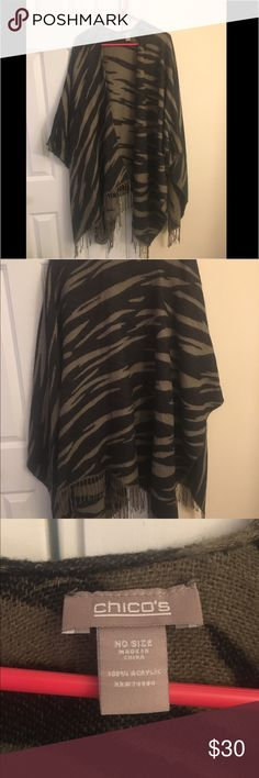 Chicos- No Sz Black & Tan zebra print knit poncho Very classy Black and Tan poncho. Can be paired with pants or a dress. Very soft and warm and in brand new condition! Chico's Sweaters Shrugs & Ponchos