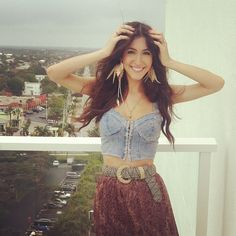 Windy day on the balcony shooting a fun little vid for you guys! Hair is going nuts -Kate Voegele