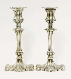 A pair of silver candlesticks,by Stephenson & Sons, Birmingham 1912,with fluted knopped stems, on lo