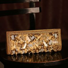 Pearl Studded Beautiful Golden Clutch